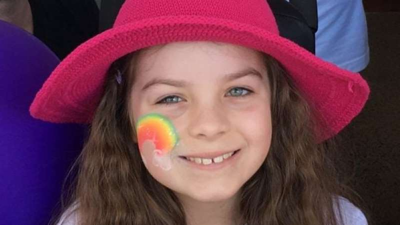a close up of a girl wearing a hat: Chloe Saxby lost her battle with vanishing white matter disease on November 18. (Facebook: Saving Chloe Saxby)