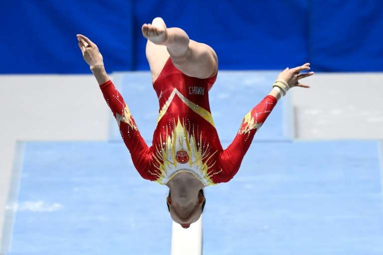 a person jumping in the air: Tokyo hosted an international gymnastics event this month