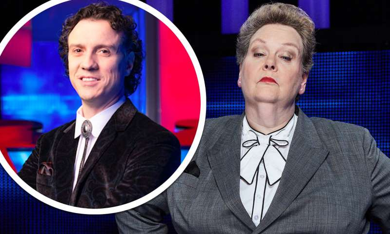Anne Hegerty standing in front of a mirror posing for the camera: MailOnline logo
