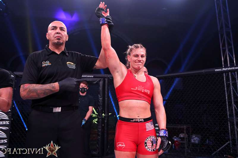 Kayla Harrison standing on a stage: kayla-harrison-invicta-fc-43-9