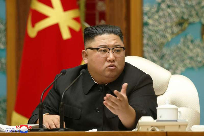 Kim Jong-un sitting on a table: North Korean leader Kim Jong Un at a political meeting in Pyongyang, in an undated photo released by North Korean state media on Nov. 16.