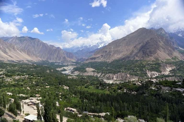 a large mountain in the background: The Hunza Valley in Pakistan's north, where Baba Jan is from, is home to some of the highest mountains in the world and is also claimed by India