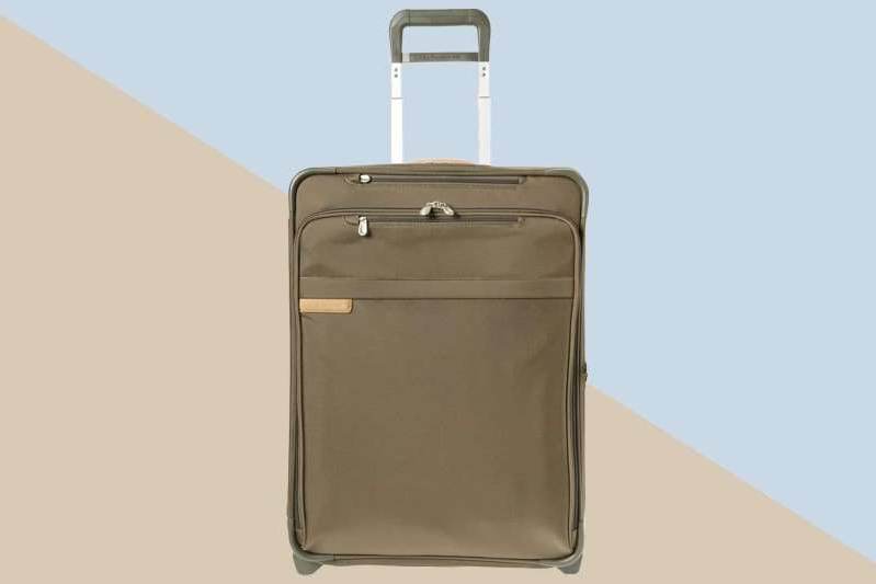 a piece of luggage sitting on top of a suitcase: Courtesy of Nordstrom
