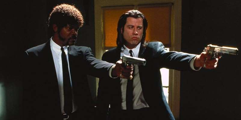 John Travolta wearing a suit and tie: John Travolta and Samuel L. Jackson starred in