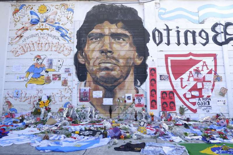 map: Fans place offerings to Diego Maradona outside Argentinos Juniors' Stadium Diego Maradona on November 26, 2020 in Buenos Aires, Argentina. Maradona died of a heart attack at his home on Thursday 25 aged 60.