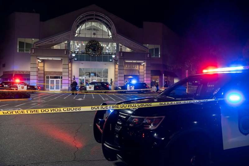 Sacramento police work at the area where one person was killed and another critically wounded in a shooting at Arden Fair Mall in Sacramento, Calif., Friday, Nov 27, 2020. The mall was evacuated in the midst of Black Friday, one of the busiest shopping days. Police later said the suspect had fled and there was no active threat to the mall.