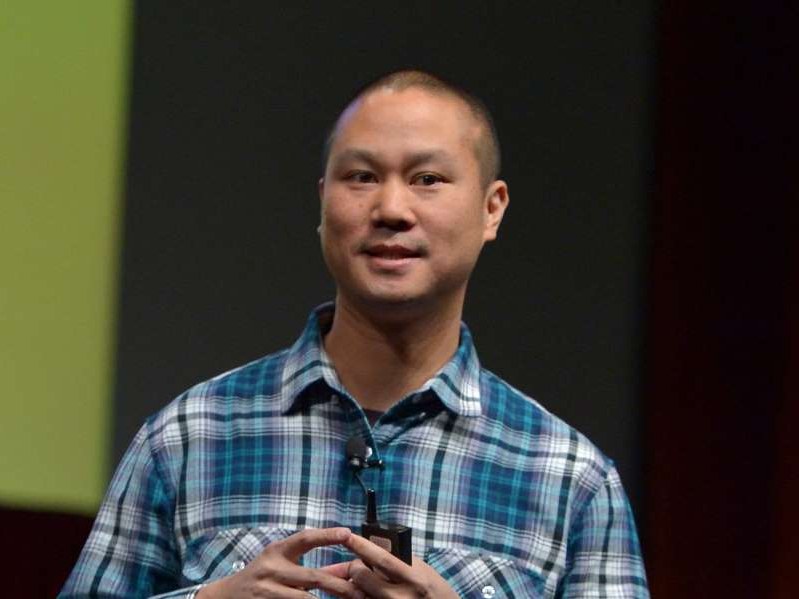Tony Hsieh looking at the camera: Hsieh speaks onstage at CinemaCon's final day luncheon and special presentation.