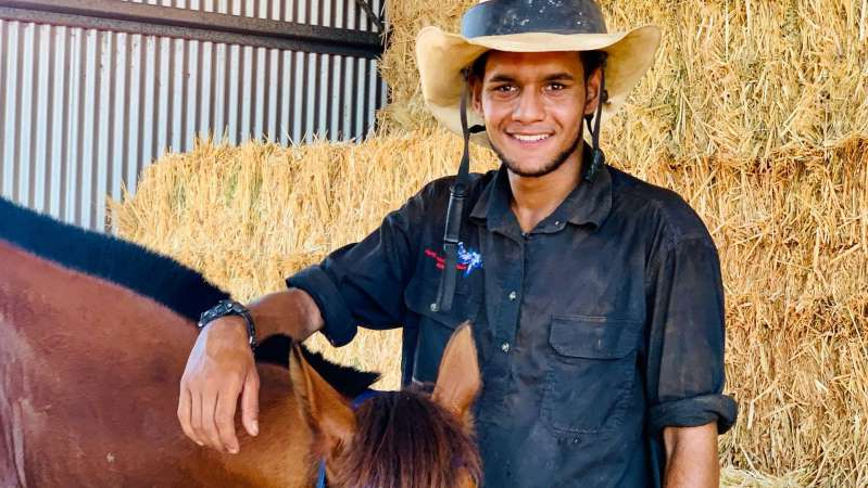 a man wearing a hat: Eighteen-year-old Tim Mallard took part in his first cattle muster at Roebuck Plains Station this year. (ABC Kimberley: Erin Parke)