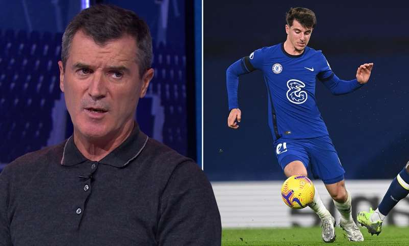 Roy Keane holding a football ball: MailOnline logo