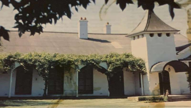 a person standing in front of a building: This photo of the Woomargama homestead appeared in a 1983 edition of New Idea magazine. (Supplied: Clare Cannon)