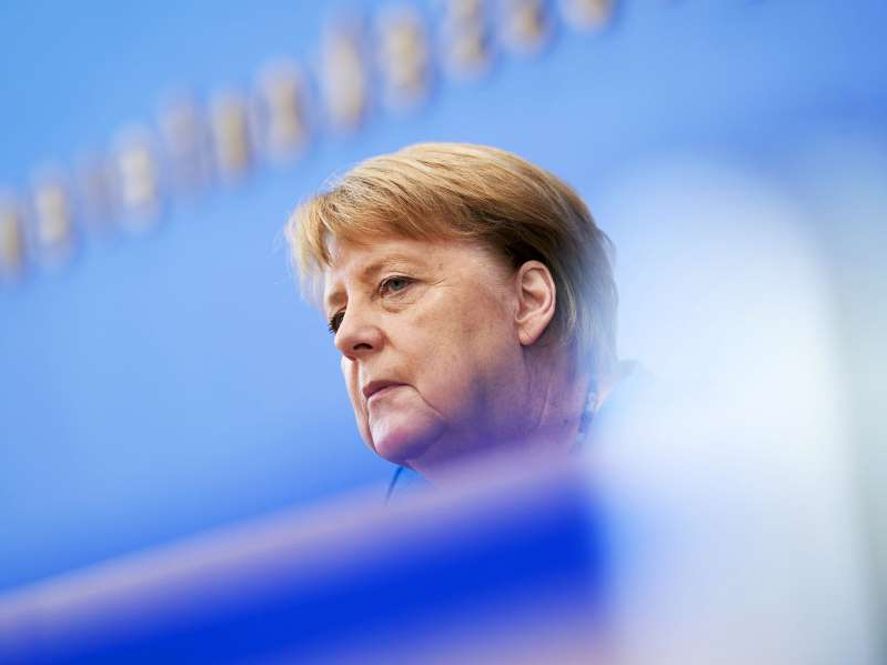 Angela Merkel looking at the camera: BERLIN, GERMANY - AUGUST 28: German Chancellor Angela Merkel speaks to the media at her annual summer press conference during the coronavirus pandemic on August 28, 2020 in Berlin, Germany. Merkel is likely to speak on a range of issues, including the pandemic and the economy. (Photo by Henning Schacht - Pool/ Getty Images)