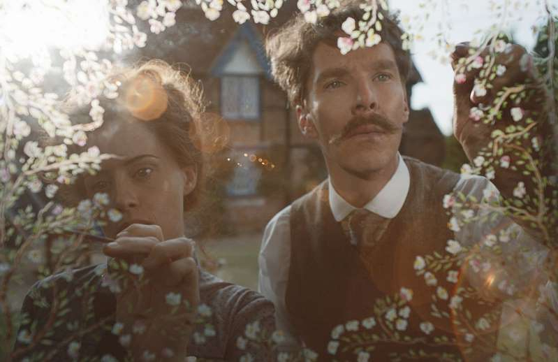 Benedict Cumberbatch standing in front of a mirror posing for the camera: Benedict Cumberbatch and Claire Foy in Louis Wain biopic