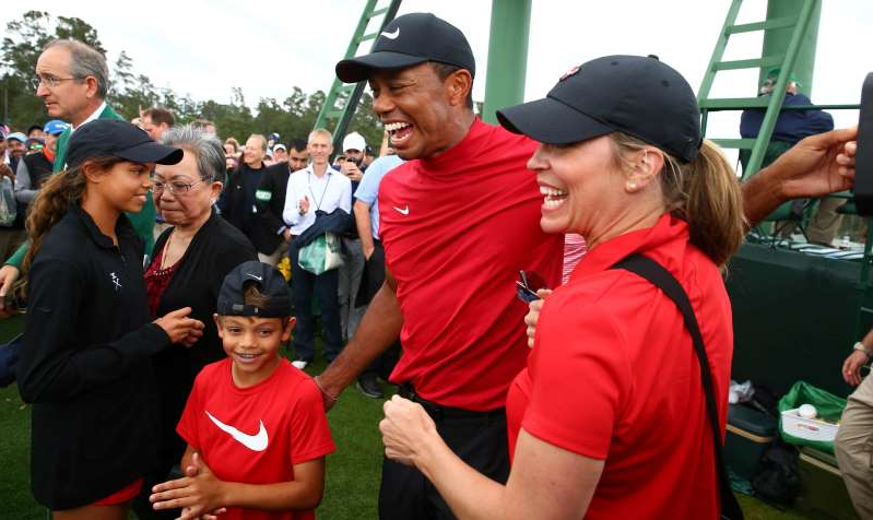 Brian L. Roberts et al. standing in front of a crowd: Apr 14, 2019; Augusta, GA, USA; Tiger Woods celebrates with daughter Sam and son Charlie after winning The Masters golf tournament at Augusta National Golf Club. Mandatory Credit: Rob Schumacher-USA TODAY Sports
