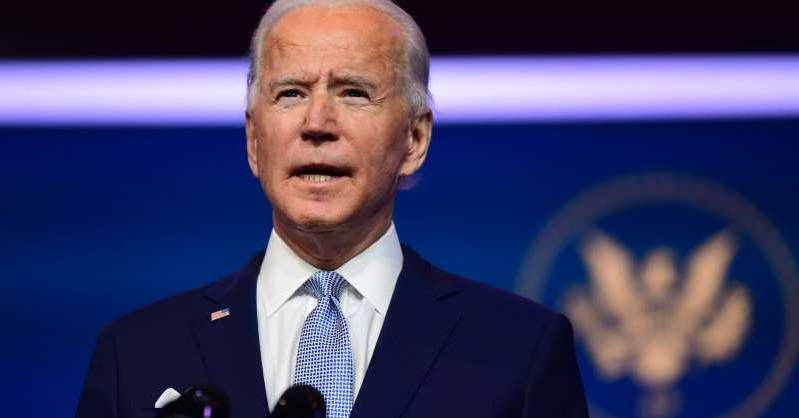 Joe Biden wearing a suit and tie: President-elect Joe Biden introduces key foreign policy and national security nominees and appointments at the Queen Theatre on November 24, 2020 in Wilmington, Delaware.