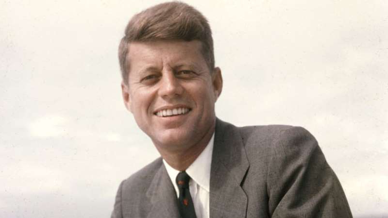 John F. Kennedy wearing a suit and tie smiling at the camera: Hank Walker/The LIFE Picture Collection/Getty