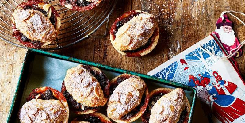 a box filled with different types of food: Chewy almond biscuits make a beautiful mince pie topping.