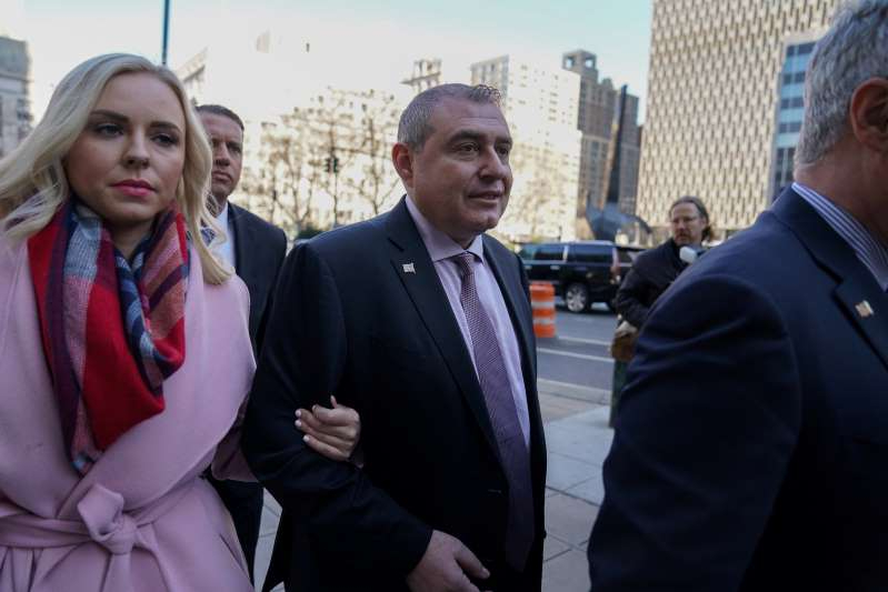 a group of people posing for the camera: FILE PHOTO: Ukrainian-American businessman Lev Parnas arrives for a hearing at the Manhattan Federal Court in the Manhattan borough of New York