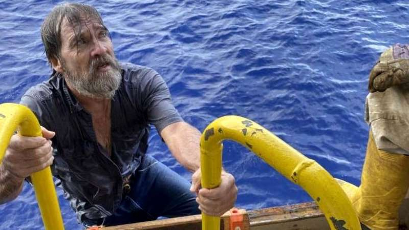 a man holding a banana: Stuart Bee, 62, was rescued by a passing container ship 86 miles (138km) off the Florida coast on Sunday