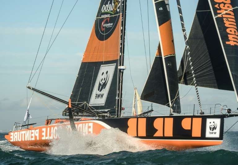 an orange boat on a body of water: French skipper Kevin Escoffier had to abandon his Imoca class 60 monohull PRB in the Atlantic oiff the Cape of Good Hope