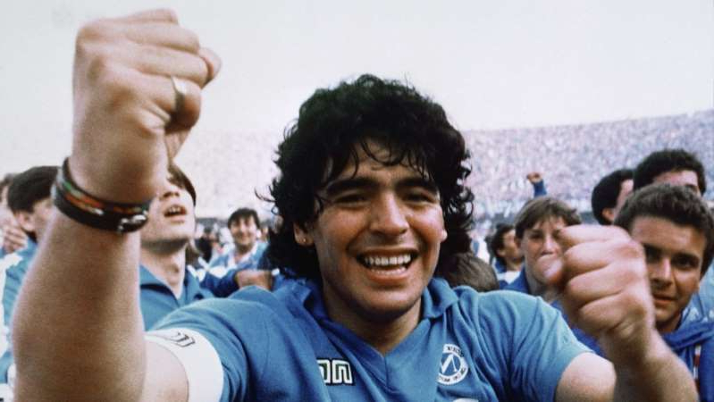 Diego Maradona et al. taking a selfie: Argentine soccer superstar Diego Armando Maradona cheers after the Napoli team clinched its first Italian major league title in Naples, Italy, on May 10, 1987.