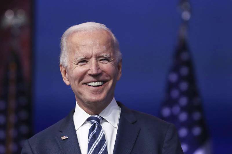 Joe Biden wearing a suit and tie: WILMINGTON, DELAWARE - NOVEMBER 10: U.S. President-elect Joe Biden addresses the media about the Trump Administration's lawsuit to overturn the Affordable Care Act on November 10, 2020 at the Queen Theater in Wilmington, Delaware. Mr. Biden also answered questions about the process of the transition and how a Biden Administration would work with Republicans. (Photo by Joe Raedle/Getty Images)