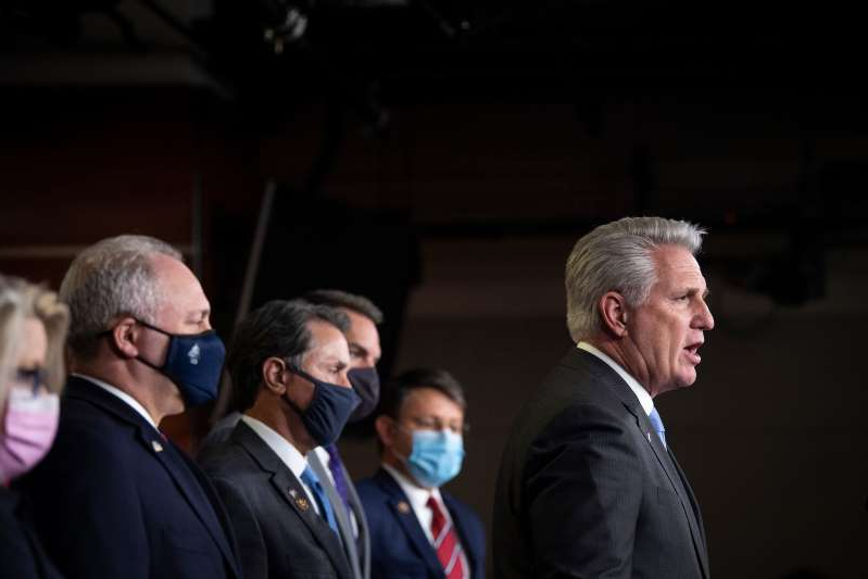 Kevin McCarthy wearing a suit and tie standing in front of a crowd: House Republicans have reasons to be optimistic about the 2022 midterms, but nothing is guaranteed about the political landscape in two years time, Rothenberg writes.