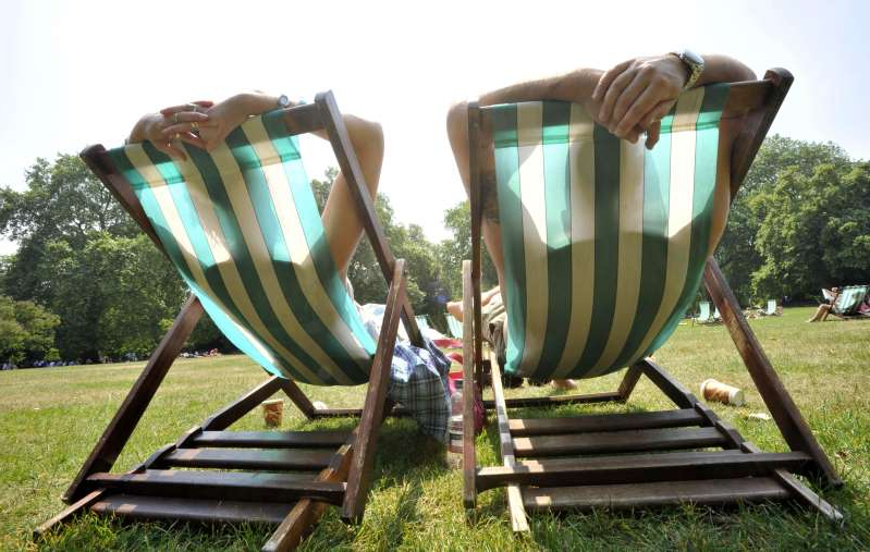 a couple of lawn chairs sitting on top of a wooden chair: Tanning beds and sunbathing 'may be linked to increased risk of endometriosis' (Tim Ireland/PA)