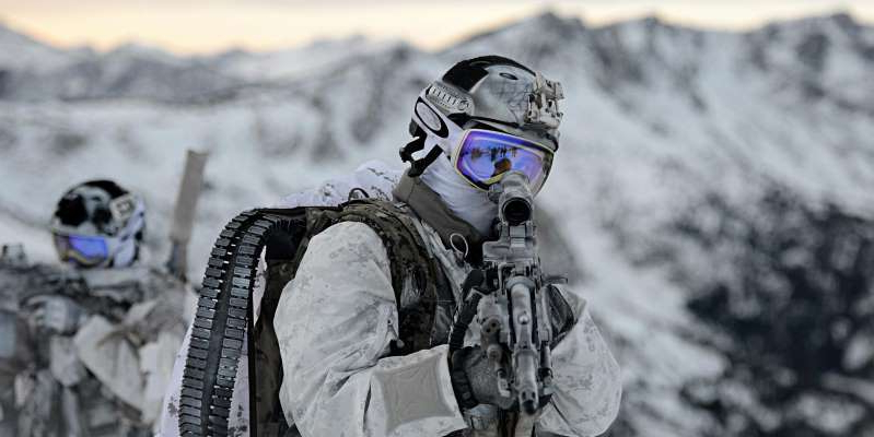 a pile of snow: US Navy SEALs. Department of Defense