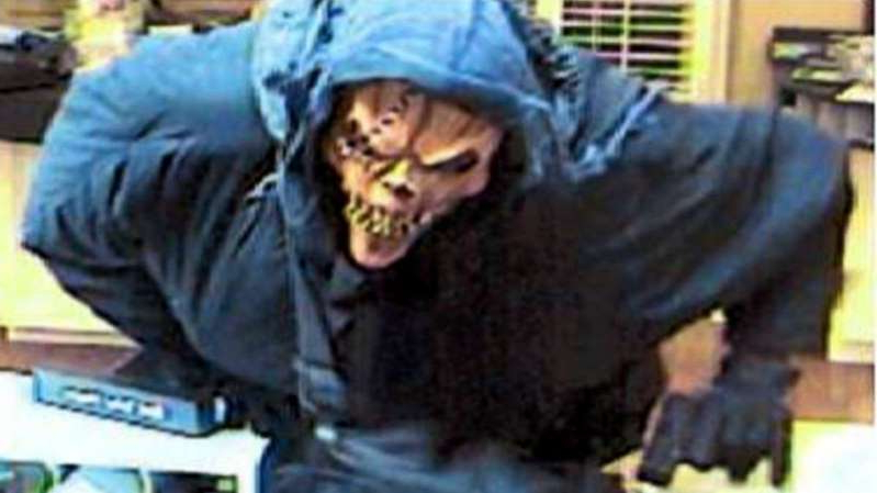 a person wearing a costume: A serial bank robber dubbed the