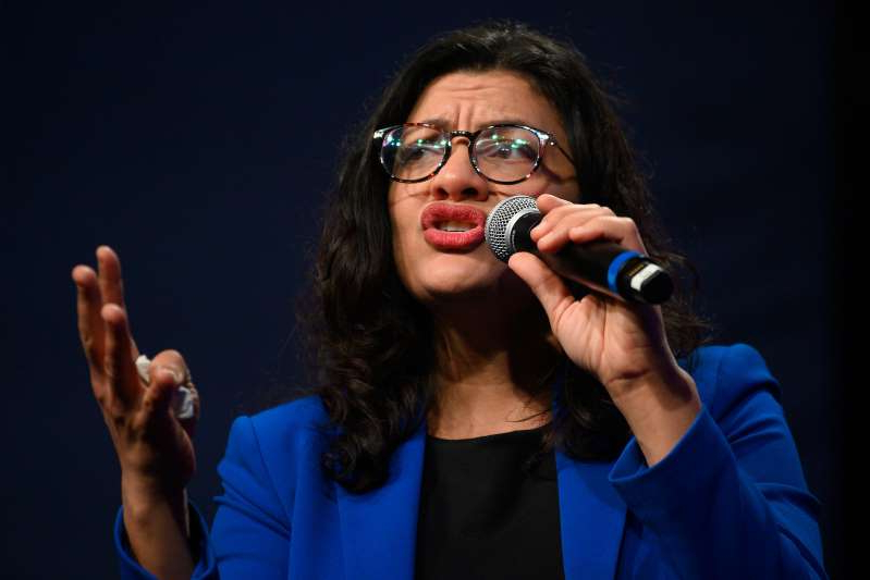 Rashida Tlaib wearing sunglasses and smoking a cigarette: Congresswoman Rashida Tlaib, D-MI, speaks to supporters of Democratic presidential candidate Senator Bernie Sanders at a campaign event in Clive, Iowa, on January 31, 2020. She has made calls for further stimulus checks to be sent out amid the COVID-19 pandemic.