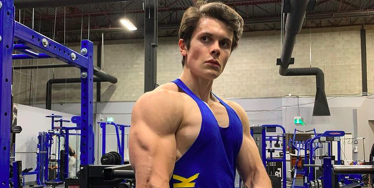 a person posing for the camera: Fitness YouTuber Will Tennyson breaks down his five weekly workouts which include compound lifts and supersets, as well as his approach to nutrition.