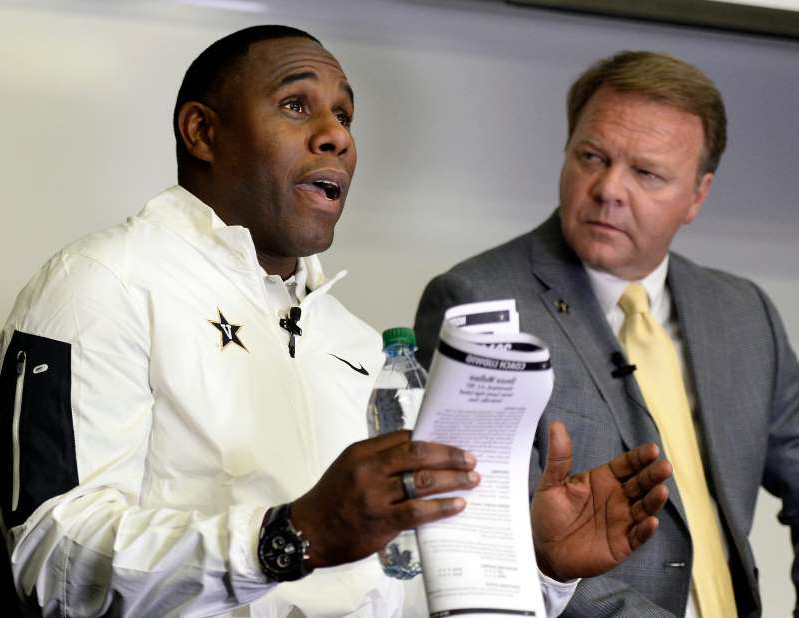 Derek Mason holding a wine glass: Vanderbilt coach Derek Mason, left, speaks as and Joe Fisher, director of broadcasting, listens during a National Signing Day recruiting event at Vanderbilt on Wednesday, Feb. 3, 2016.