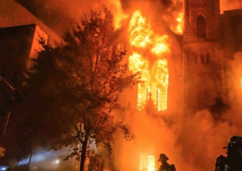 a bright light in a dark room with smoke and fire: Church fire (FDNY)
