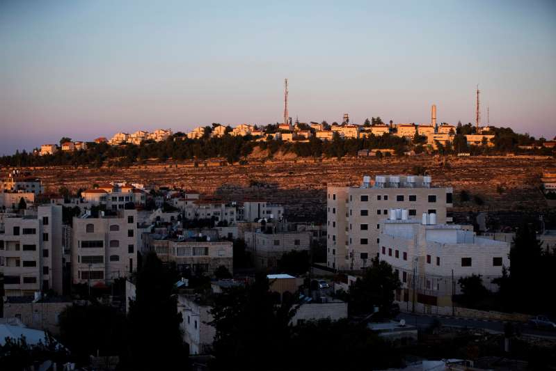 a large body of water with a city in the background: Jewish settlements on Palestinian land captured by Israel in 1967 have long been a stumbling block in the peace process [AP]