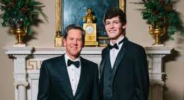 Daniel Sharman wearing a suit and tie posing for a picture: Harrison Deal (left), shown here with Georgia Gov. Brian Kemp, was killed Friday in an automobile accident.