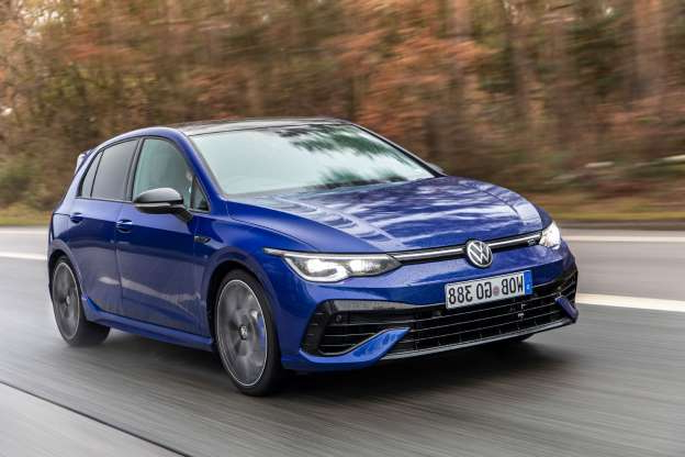 a blue car on a road: Volkswagen Golf R 2021 review