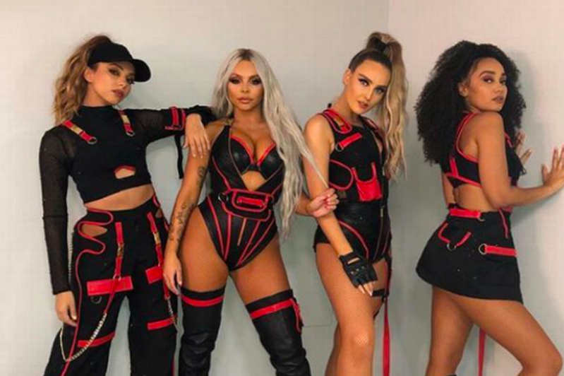 a group of people posing for the camera: Jesy Nelson said being in the band took its toll on her mental health