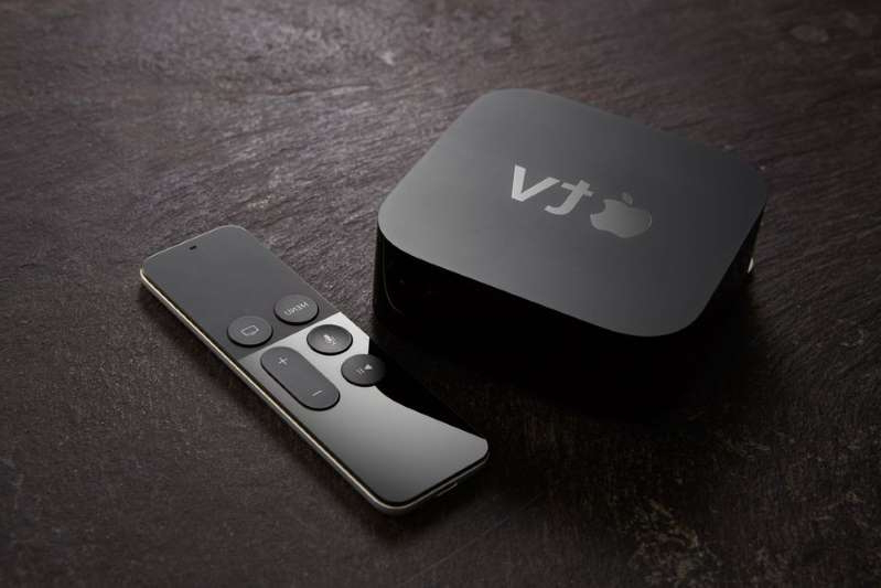 a remote control sitting on a table: The Apple TV remote gets the job done, as long as you don't lose it. Edge Magazine