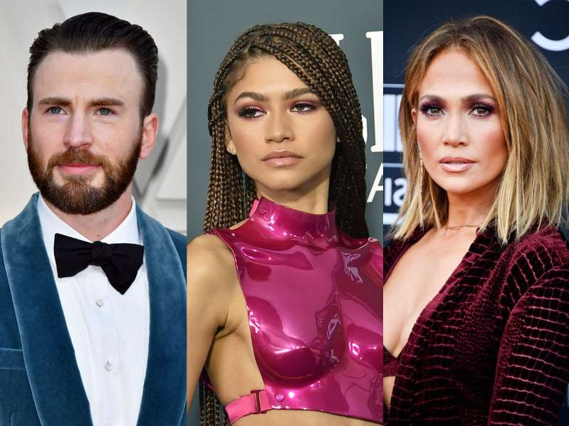 Jennifer Lopez, Zendaya, Chris Evans posing for the camera: Jennifer Lopez, Zendaya, and Chris Evans. Getty Images