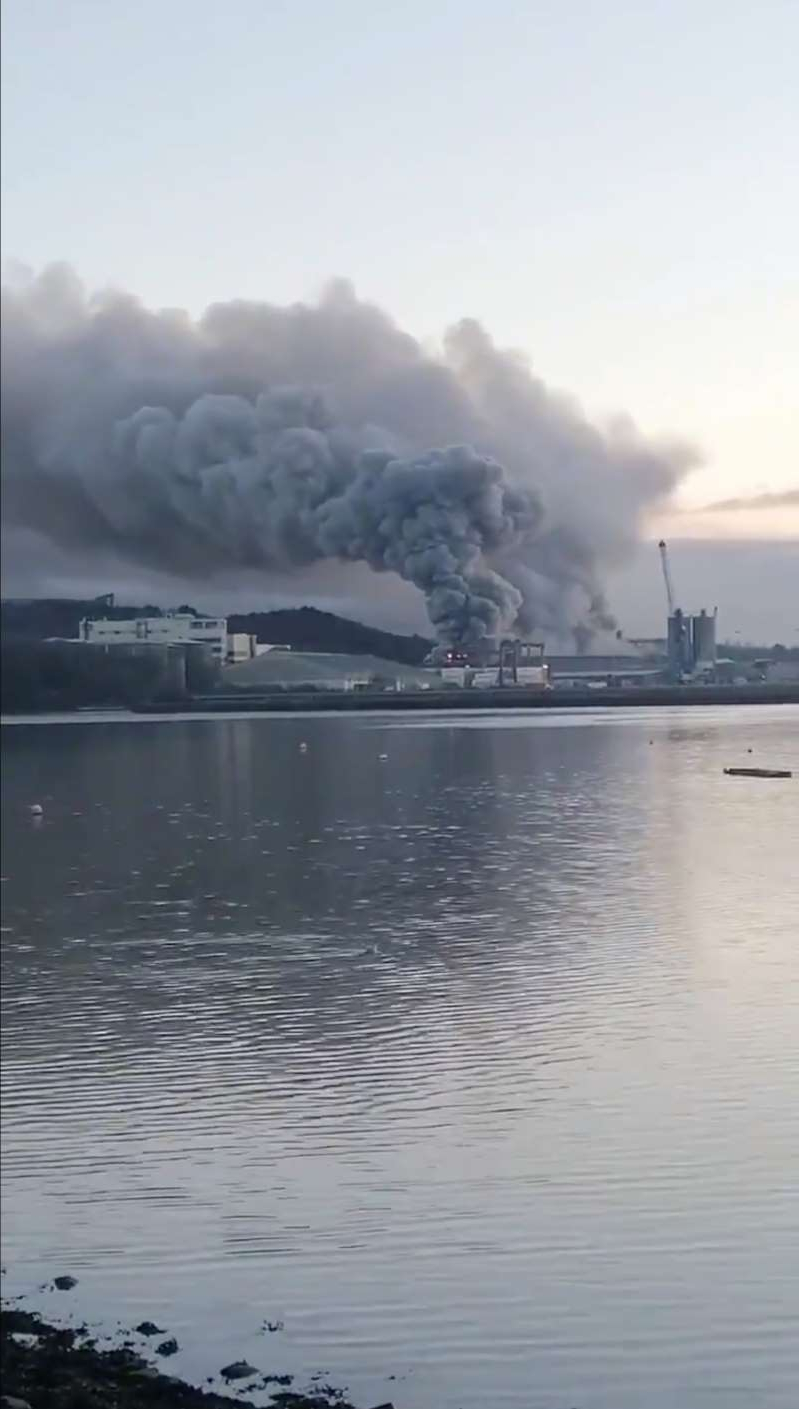 a large body of water with smoke coming out of it: Large blaze at Ireland's Port of Cork