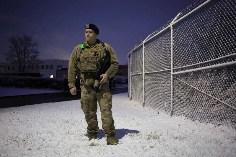 a man that is standing in the snow: Tech Sgt. Bryan Moody, a member of the Kentucky Air National Guard Security Forces, was part of an Air Force security forces team on the night of the Iranian attack.