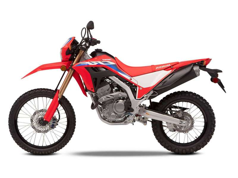 a motorcycle that is jumping in the air: Honda's smallest street-legal CRF gets a displacement increase, more suspension travel and ground clearance, and a claimed 11-pound weight loss for 2021 with its new CRF300L.