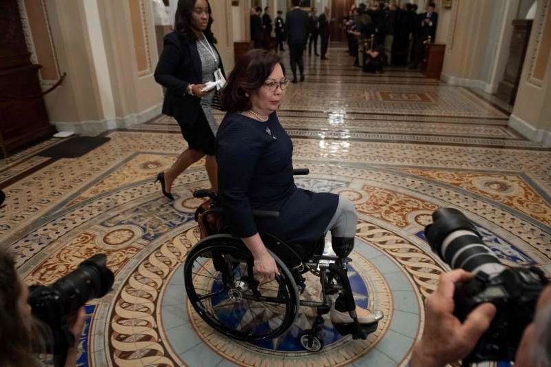 Tammy Duckworth sitting on a bicycle: Sen. Tammy Duckworth, D-Ill., says authorities must bring