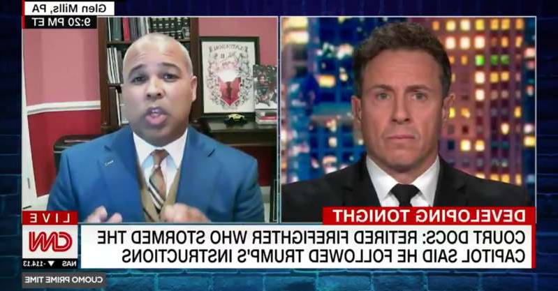 Chris Cuomo wearing a suit and tie