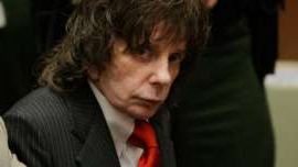a young man wearing a suit and tie: LOS ANGELES, CA - MAY 29: Phil Spector (L) listens to the judge during sentencing in Los Angeles Criminal Courts on May 29, 2009 in Los Angeles, Californial, for the February 2003 shooting death of actress Lana Clarkson. Spector was sentenced for 19-years to life. (Photo by Jae C. Hong-Pool/Getty Images)