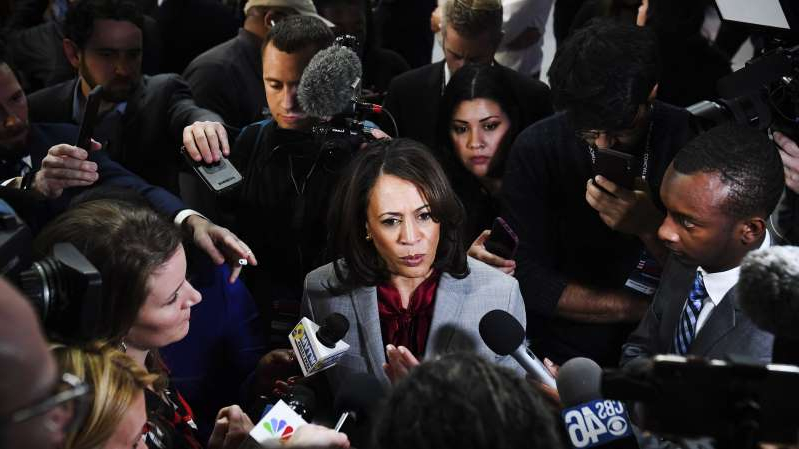 Kamala Harris et al. standing in front of a crowd: Sen. Kamala Harris speaks to reporters after the fifth Democratic primary debate on November 20, 2019.