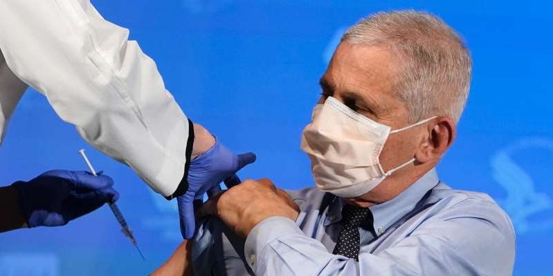 a man wearing sunglasses: Dr. Anthony Fauci, director of the National Institute of Allergy and Infectious Diseases, prepares to receive his first dose of a COVID-19 vaccine at the National Institutes of Health on December 22, 2020 in Bethesda, Maryland. Patrick Semansky-Pool/Getty Images