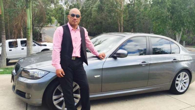 a person standing in front of a car posing for the camera: Taufao, a New Zealand citizen, will face deportation when he is released from prison. (Facebook)