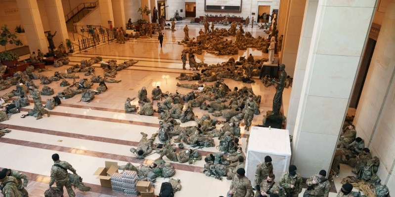 National Guard troops rest in the US Capitol while on a break. AP Photo/J. Scott Applewhite