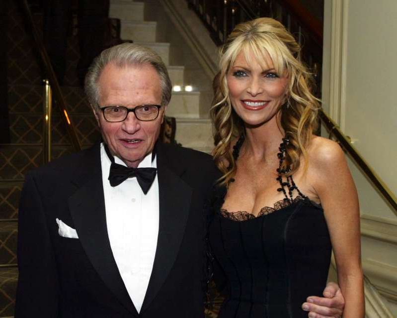 Shawn King, Larry King posing for a picture: Larry King and his then-wife Shawn Southwick King in 2003.